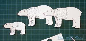 Eisbärenfamilie mit geprickelten Pullovern