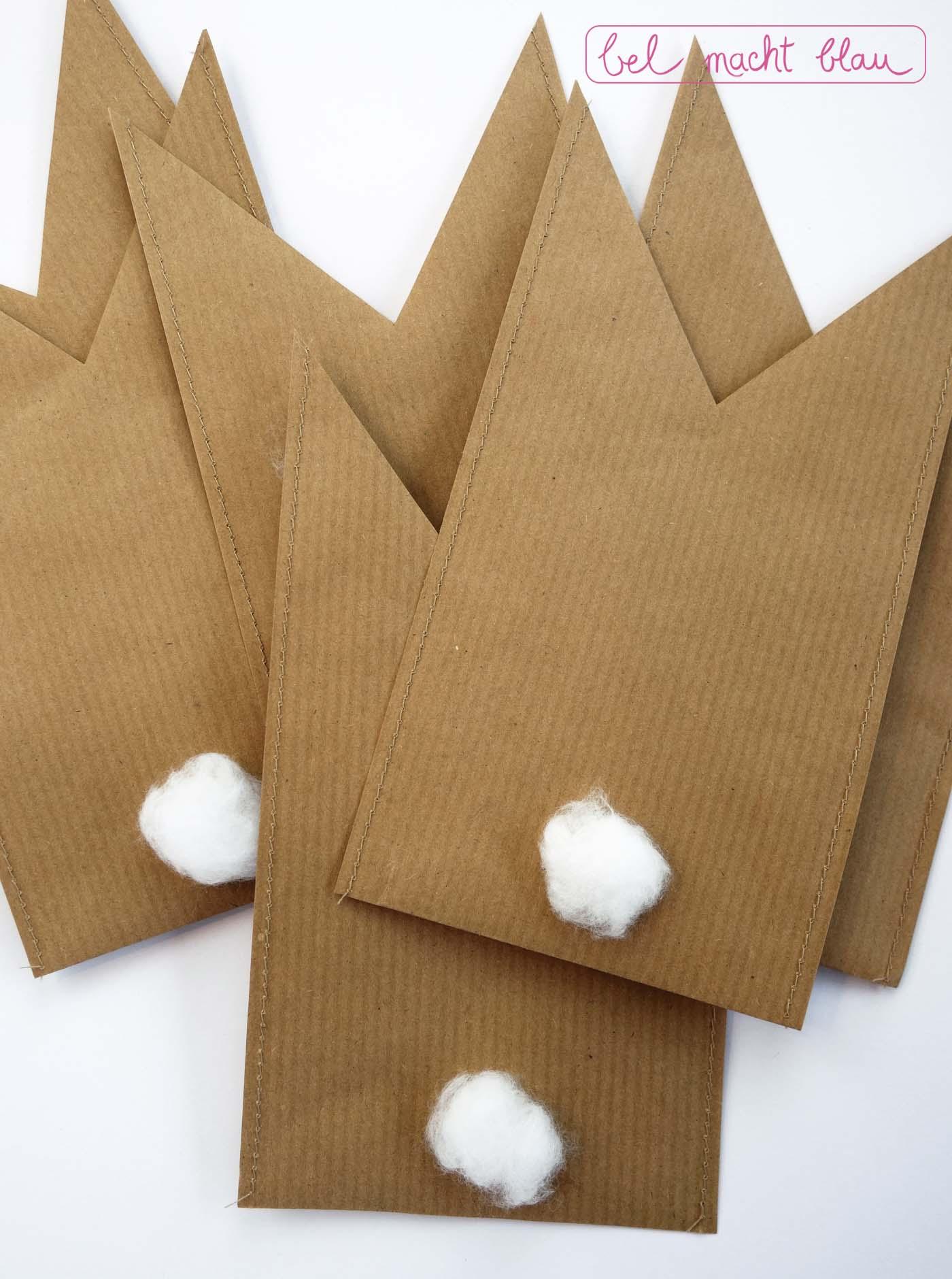 Packpapiertüten mit Puschelschwänzen verzieren